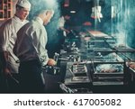 food concept. chef in white... | Shutterstock . vector #617005082