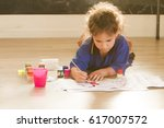 young happy child girl coloring ... | Shutterstock . vector #617007572