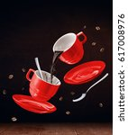 flying red cups with coffee in... | Shutterstock . vector #617008976