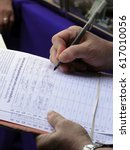 man signing a petition for a... | Shutterstock . vector #617010056
