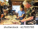 grandfather and grandson work... | Shutterstock . vector #617055785