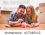 young couple is saving money... | Shutterstock . vector #617185112