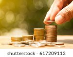 Small photo of Man drop coin on coin bar show accumulation or savings of money.