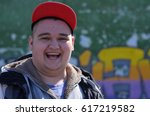 cheerful guy in a cap. orsk ... | Shutterstock . vector #617219582