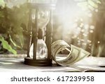 Time is money business philosophy. Hourglass with dollar bills. - stock photo