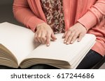books braille. the touch of... | Shutterstock . vector #617244686