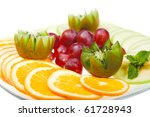 fresh snack with fruits and grapes on white plate - stock photo