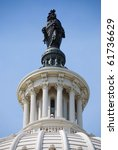 Stock photo statue of freedom over capitol hill building in washington dc 61736629