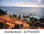 waikiki coastal road at dusk.... | Shutterstock . vector #617410655
