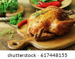 whole roasted chicken on... | Shutterstock . vector #617448155