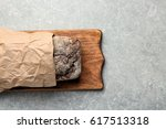 board with tasty loaf of beer... | Shutterstock . vector #617513318
