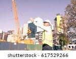 engineer man in helmet and... | Shutterstock . vector #617529266