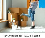 happy young couple moving in... | Shutterstock . vector #617641055