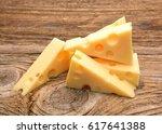 slice of cheese on wooden...   Shutterstock . vector #617641388