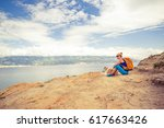 woman hiking with akita inu dog ... | Shutterstock . vector #617663426