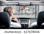 man in white t shirt driving a... | Shutterstock . vector #617678036