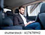 handsome businessman working...   Shutterstock . vector #617678942