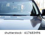 handsome businessman driving a... | Shutterstock . vector #617683496