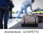 wheeled suitcase on a luggage... | Shutterstock . vector #617695772