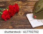military letters under the cap... | Shutterstock . vector #617702702