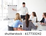 business trainer giving... | Shutterstock . vector #617733242