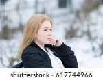 cute and pensive blonde young... | Shutterstock . vector #617744966