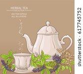 cup of elderberry tea and teapot | Shutterstock .eps vector #617745752