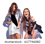 fashion portrait of two smiling ... | Shutterstock . vector #617746082