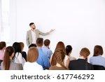 business trainer giving... | Shutterstock . vector #617746292