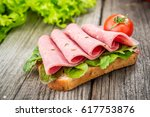 fastfood. sandwich with bacon... | Shutterstock . vector #617753876