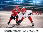 young children play ice hockey  | Shutterstock . vector #617759075
