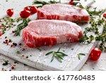 Raw pork loin chops on a...
