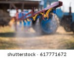 the tractor sprinkles the... | Shutterstock . vector #617771672