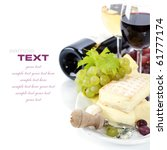 Grape and cheese with a bottle and glasses of red and white wine (with sample text) - stock photo