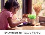 asian little girl is playing... | Shutterstock . vector #617774792