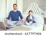 father and daughter are... | Shutterstock . vector #617797406