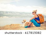 woman hiking with akita inu dog ... | Shutterstock . vector #617815082