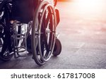 Small photo of Close-up Empty wheelchair in front of the Outpatient Department of Hospital with sunlight
