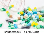 medicine pills or capsules on... | Shutterstock . vector #617830385