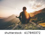 Stock photo man meditating yoga at sunset mountains travel lifestyle relaxation emotional concept adventure 617840372