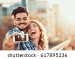 happy young couple hugging and... | Shutterstock . vector #617895236