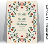 indian wedding invitation card... | Shutterstock .eps vector #617900396