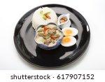pork curry seasoned with bird... | Shutterstock . vector #617907152