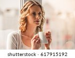 beautiful woman is holding a... | Shutterstock . vector #617915192