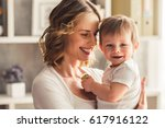 beautiful mom is playing with... | Shutterstock . vector #617916122