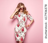 blonde young woman in floral... | Shutterstock . vector #617936378