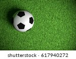 soccer ball on green grass 3d... | Shutterstock . vector #617940272