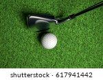 golf ball on green grass 3d... | Shutterstock . vector #617941442