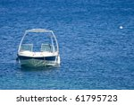 Small White Boat On A Calm Sea
