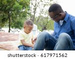 happy african american father... | Shutterstock . vector #617971562